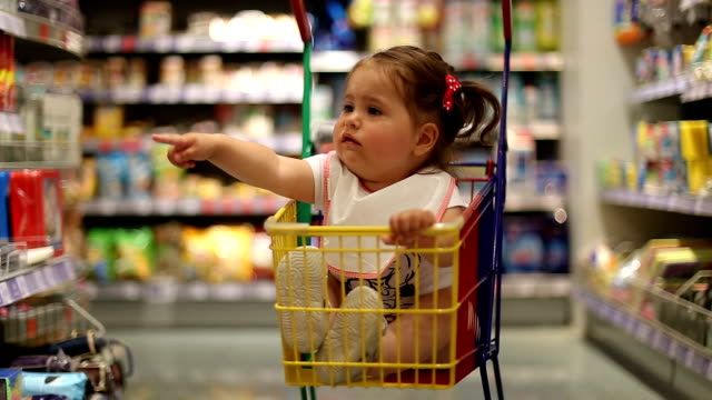 baby girl in shopping cart sitting and demanding video