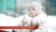 Baby Girl on the playground in winter video