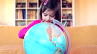 HD Baby girl play with a globe video