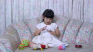 Baby Girl playing smartphone video