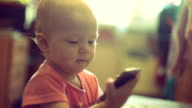 Baby girl playing with cell phone video