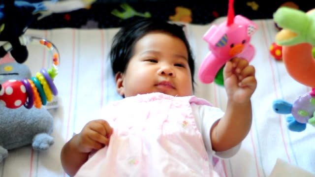 Baby girl playing with her toys video