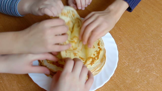 baby hands take the pancakes on a plate video