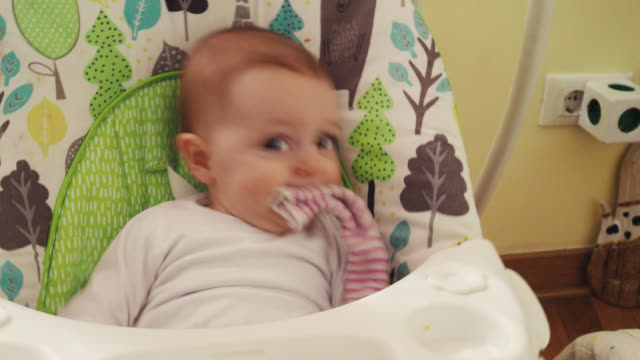 Baby in armchair video