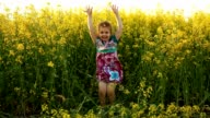 Baby in the flowers. Laugh. video