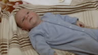 Baby lying in bed - Close up & medium shot video