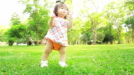 Baby on grass, dolly shot. video