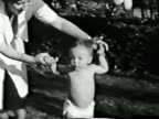 Baby, parents & toy--From 1930's film video