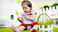 A baby playing by his crib in his room video