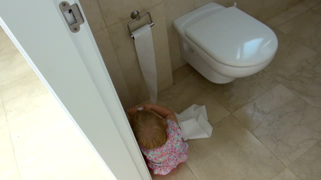 baby playing with toilet paper video