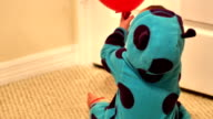 Baby plays with balloon in bedroom video