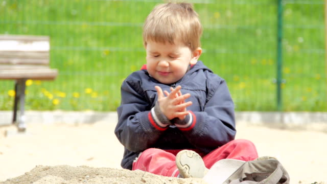 Baby Plays with Sand video
