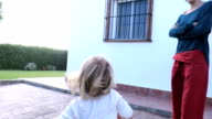 baby running in garden from barbecue video