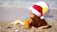 Baby Santa Claus on the beach video