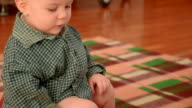 baby sitting on a children's pot video