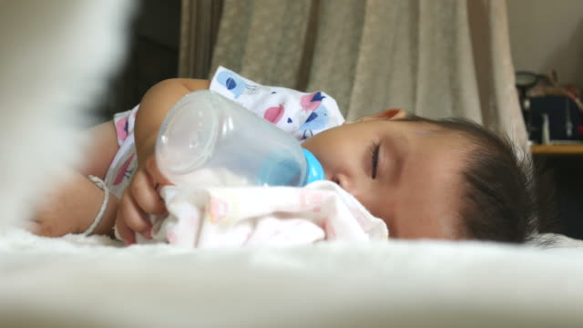 Baby sleep while drinking milk bottle video