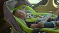 Baby Sleeping in car seat. video