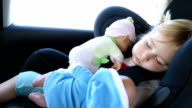 baby sleeping with dolls in car seat video