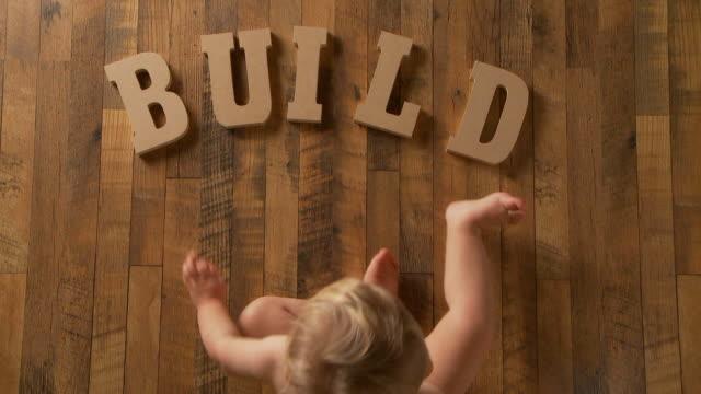 Baby spells 'Build' video