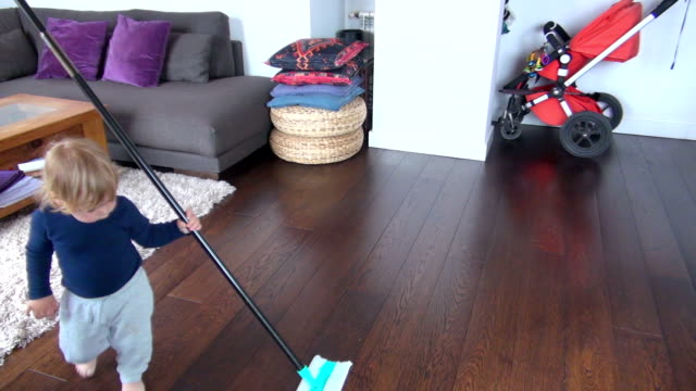 baby sweeping home video