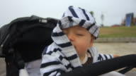 Baby Trying to Take Striped Jacket Hood Off video
