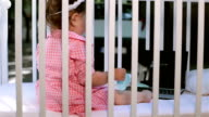 baby using lap top in a crib outside video