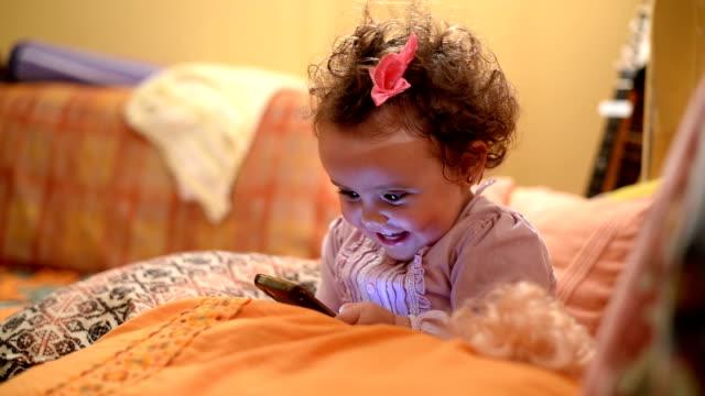 Baby using phone video