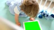 Baby watching a digital tablet iPad  (green screen) loop video