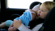 baby with dolls in car seat video