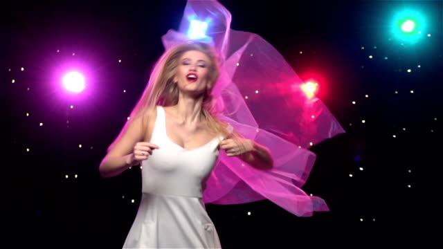 Bachelorette party bride dancing making movements of head. Slow motion video