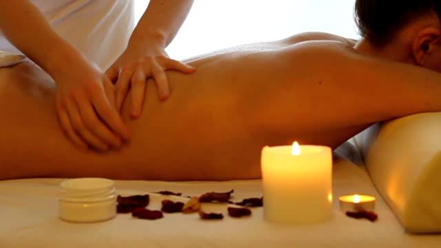 Back massage of a woman close up video