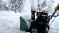 Back of the snow shredder in the winter video