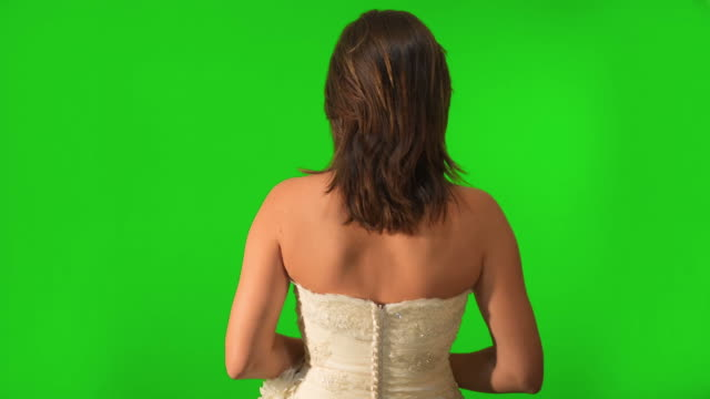 Back shot of bride walking. Shot on Green Screen video