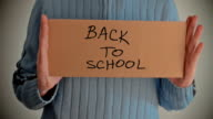 Back to School message on cardboard video