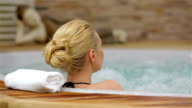 Back view of a woman enjoying jacuzzi video