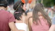 Back view of friends sitting talking at a music festival video