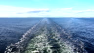 Back view of the sea washing from a cruise ship video