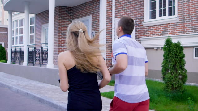 Back view of two people in motion of jogging on street video