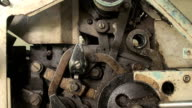 A background of a detailed view of gears from a machine, video