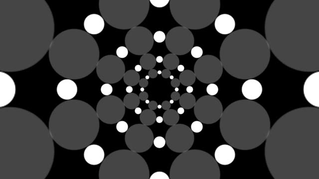 Background of circles and dots spinning in a spiral video