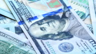Background of hundred dollars bank notes, closeup video