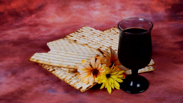 Background with matzo and wine for Jewish Passover celebration video