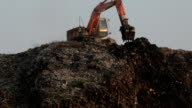 Backhoe at garbage dump video