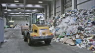 CS backhoe loader driving through the recycling facility video