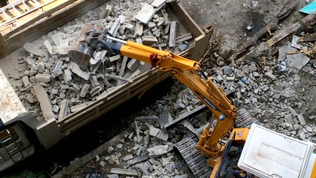 backhoe loader working on concrete waste video