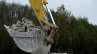 A backhoe s head with stones video