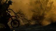 Backlit motocross rider video