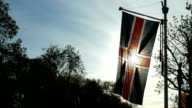 Backlit UK union flag hanging on The Mall by St James's Park. video
