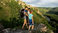 Backpacker family walks in a rock mountains video