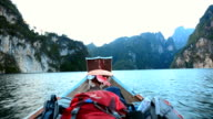 backpacker in Cheow Lan lake, Thailand by boat video